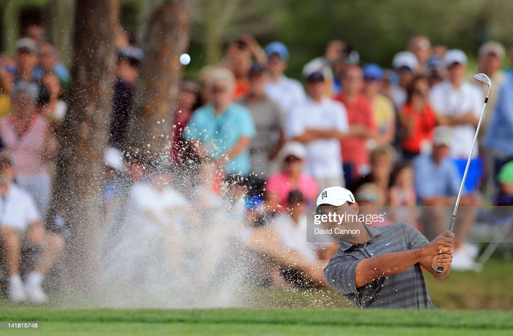 <a gi-track='captionPersonalityLinkClicked' href=/galleries/search?phrase=Tiger+Woods&family=editorial&specificpeople=157537 ng-click='$event.stopPropagation()'>Tiger Woods</a> of the USA plays his second shot at the par 3, 17th hole during the third round of the 2012 Arnold Palmer Invitational presented by MasterCard at Bay Hill Club and Lodge on March 24, 2012 in Orlando, Florida.
