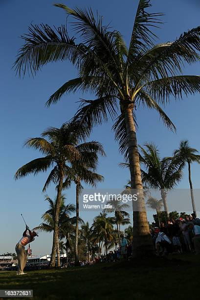 Tiger Woods of the USA plays his second shot into the 18th green during the second round of the WGC Cadillac Championship at the Trump Doral Golf...