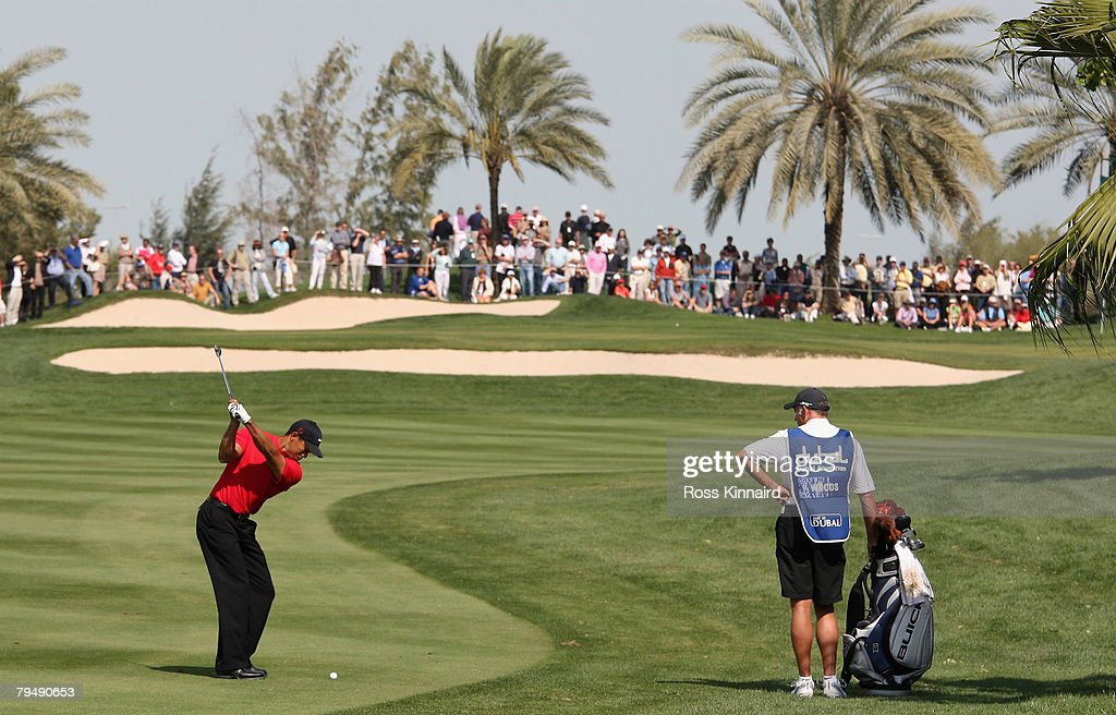 Tiger Woods of the USA plays his second shot on the par four 1st hole during the final round of the Dubai Desert Classic on the Majlis Course held at the Emirates Golf Club on February 3, 2008 in Dubai,United Arab Emirates.