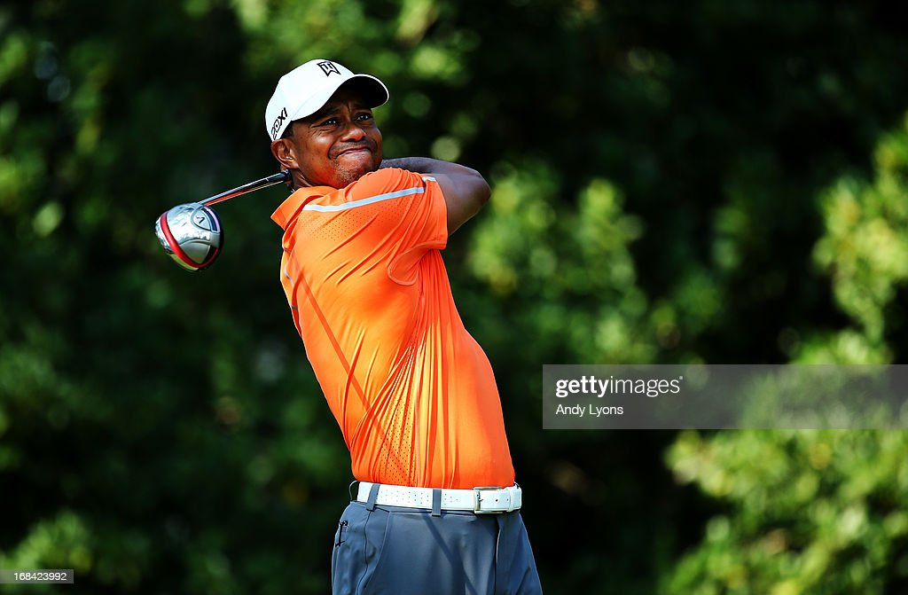 Tiger Woods of the USA plays his shot from the 11th tee during round one of THE PLAYERS Championship at THE PLAYERS Stadium course at TPC Sawgrass on May 9, 2013 in Ponte Vedra Beach, Florida.