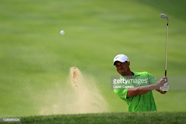 Tiger Woods of the USA plays his third shot at the 1st hole during the second round of the 2011 Omega Dubai Desert Classic on the Majilis Course at...