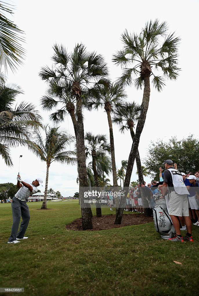 Tiger Woods of the USA plays his third shot into the 17th green during the third round of the WGC - Cadillac Championship at the Trump Doral Golf Resort & Spa on March 9, 2013 in Doral, Florida.