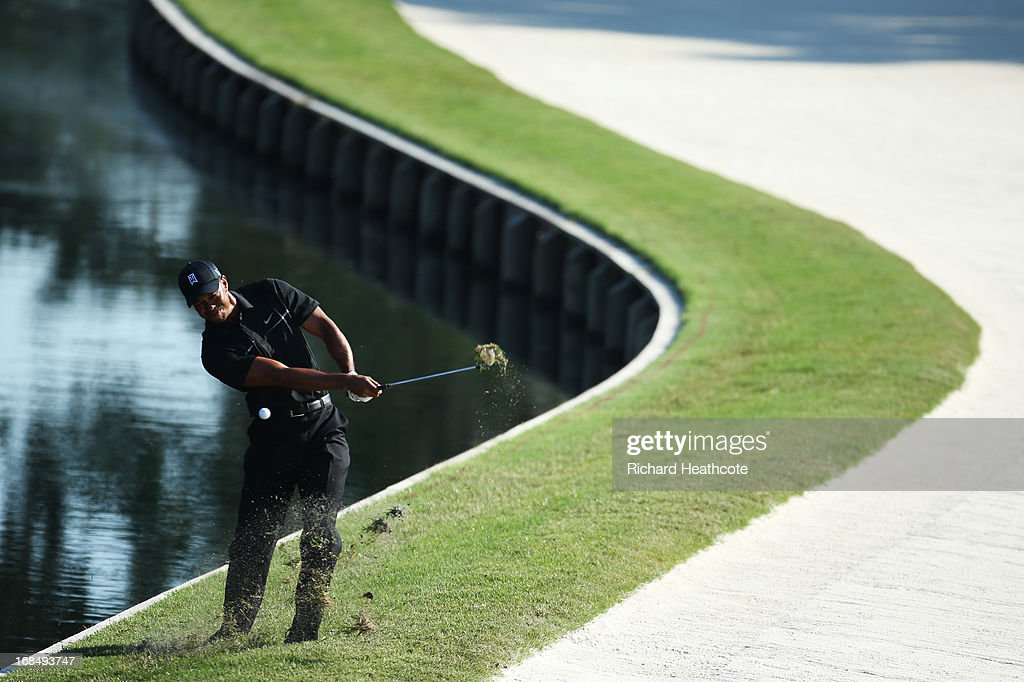 <a gi-track='captionPersonalityLinkClicked' href=/galleries/search?phrase=Tiger+Woods&family=editorial&specificpeople=157537 ng-click='$event.stopPropagation()'>Tiger Woods</a> of the USA plays his third shot on the 11th hole during round two of THE PLAYERS Championship at THE PLAYERS Stadium course at TPC Sawgrass on May 10, 2013 in Ponte Vedra Beach, Florida. Woods hit into the bunker.