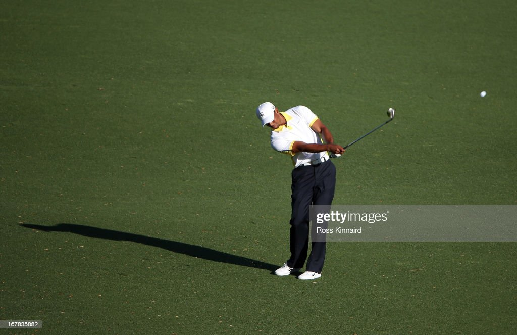 Tiger Woods of the USA plays his third shot on the par five 15th hole during the second round of the 2013 Masters at the Augusta National Golf Club on April 12, 2013 in Augusta, Georgia.