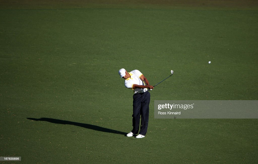 <a gi-track='captionPersonalityLinkClicked' href=/galleries/search?phrase=Tiger+Woods&family=editorial&specificpeople=157537 ng-click='$event.stopPropagation()'>Tiger Woods</a> of the USA plays his third shot on the par five 15th hole during the second round of the 2013 Masters at the Augusta National Golf Club on April 12, 2013 in Augusta, Georgia.