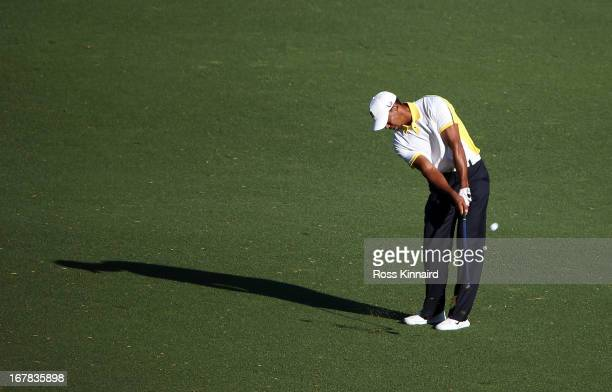 Tiger Woods of the USA plays his third shot on the par five 15th hole during the second round of the 2013 Masters at the Augusta National Golf Club...