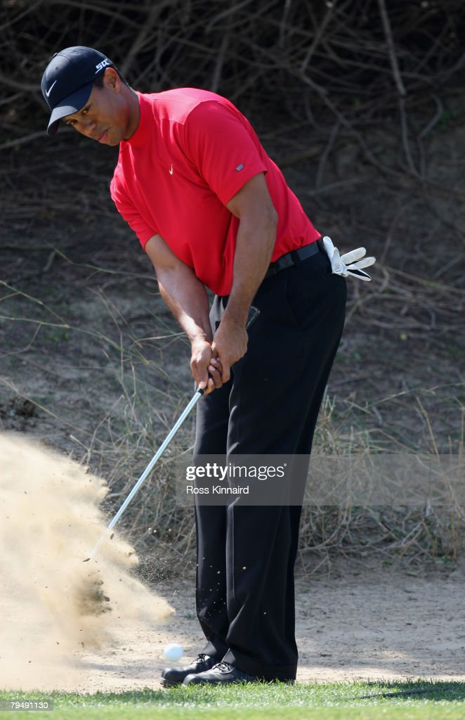 Tiger Woods of the USA plays his third shot on the par five 3rd hole during the final round of the Dubai Desert Classic on the Majlis Course held at the Emirates Golf Club on February 3, 2008 in Dubai,United Arab Emirates.