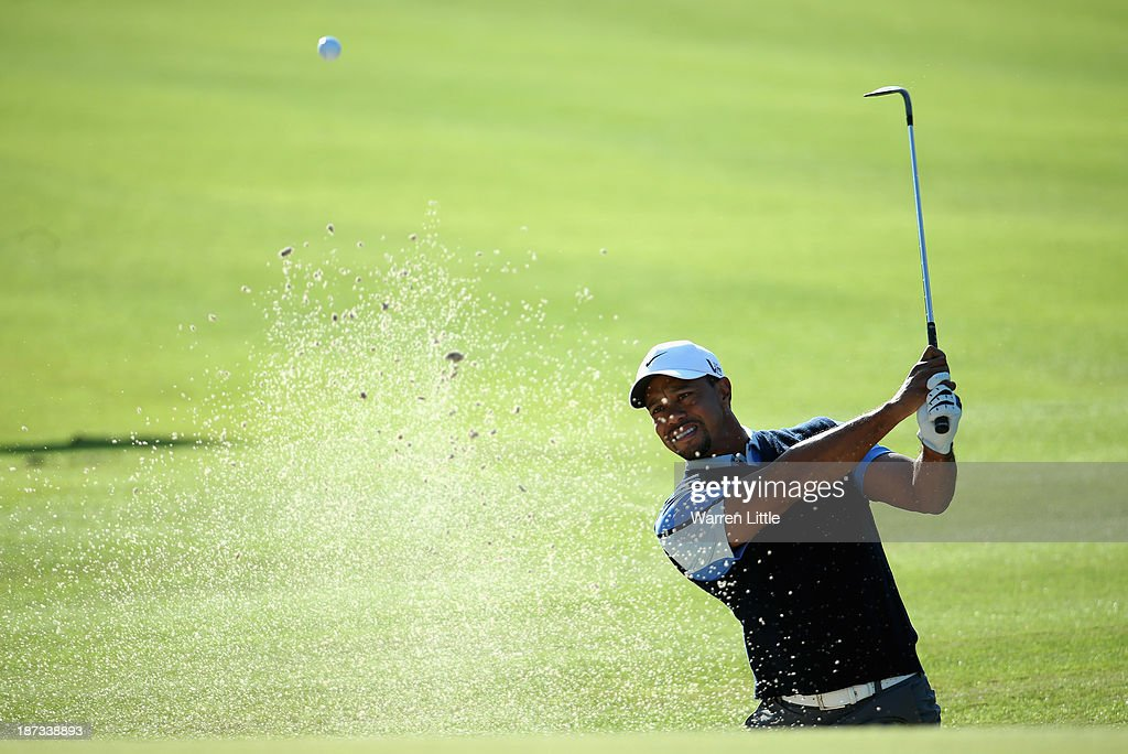 Tiger Woods of the USA plays out of the 14th greenside bunker during the first round of the Turkish Airlines Open at The Montgomerie Maxx Royal Course on November 8, 2013 in Antalya, Turkey.