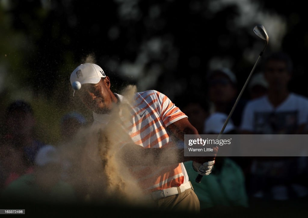 <a gi-track='captionPersonalityLinkClicked' href=/galleries/search?phrase=Tiger+Woods&family=editorial&specificpeople=157537 ng-click='$event.stopPropagation()'>Tiger Woods</a> of the USA plays out of the 15th greenside bunker during the second round of the WGC - Cadillac Championship at the Trump Doral Golf Resort & Spa on March 8, 2013 in Doral, Florida.