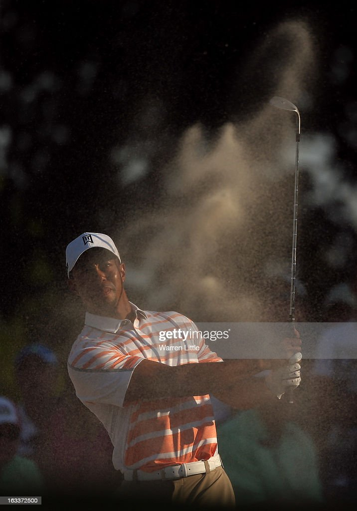 Tiger Woods of the USA plays out of the 15th greenside bunker during the second round of the WGC - Cadillac Championship at the Trump Doral Golf Resort & Spa on March 8, 2013 in Doral, Florida.