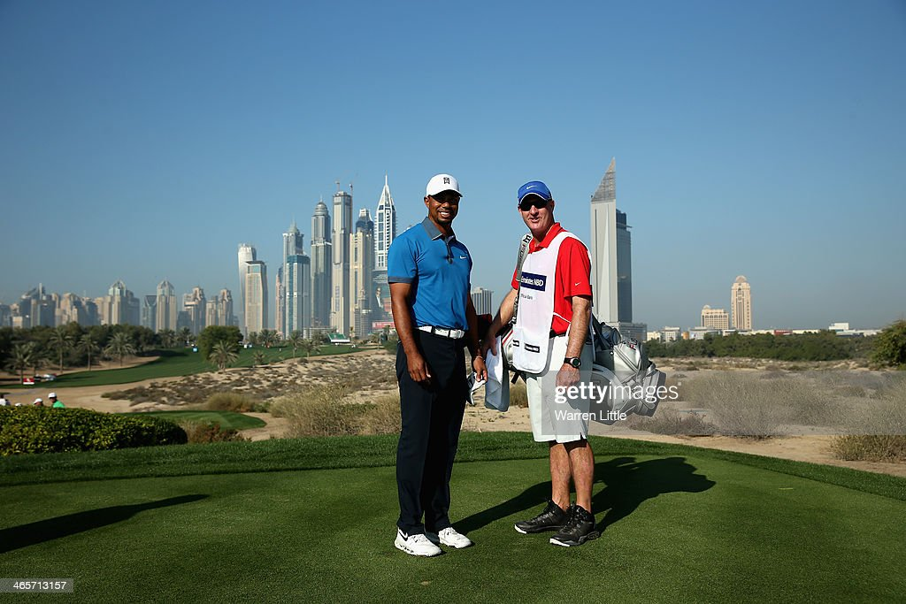 Tiger Woods of the USA poses with his caddie Joe LaCava on the eighth tee during the pro-am as a preview for the 2014 Omega Dersert Classic on the Majlis Course at the Emirates Golf Club on January 29, 2014 in Dubai, United Arab Emirates.