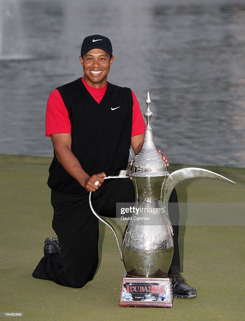 Tiger Woods of the USA poses with the trophy after winning the Dubai Desert Classic, on the Majilis Course at the Emirates Golf Club, on February 3, 2008 in Dubai, United Arab Emirates.