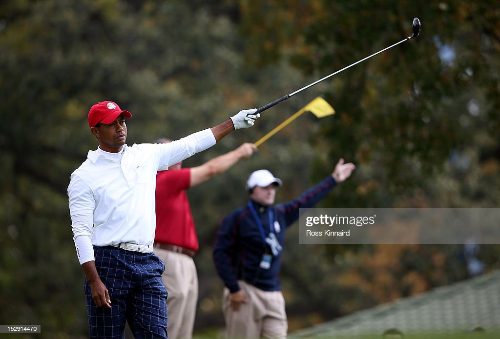 Tiger Woods of the USA reacts to a poor tee shot on the 15th hole during the Morning Foursome Matches for The 39th Ryder Cup at Medinah Country Club...