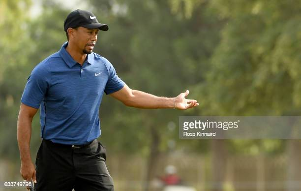 Tiger Woods of the USA reacts to his putt on 15th hole during the first round of the Omega Dubai Desert Classic at Emirates Golf Club on February 2...