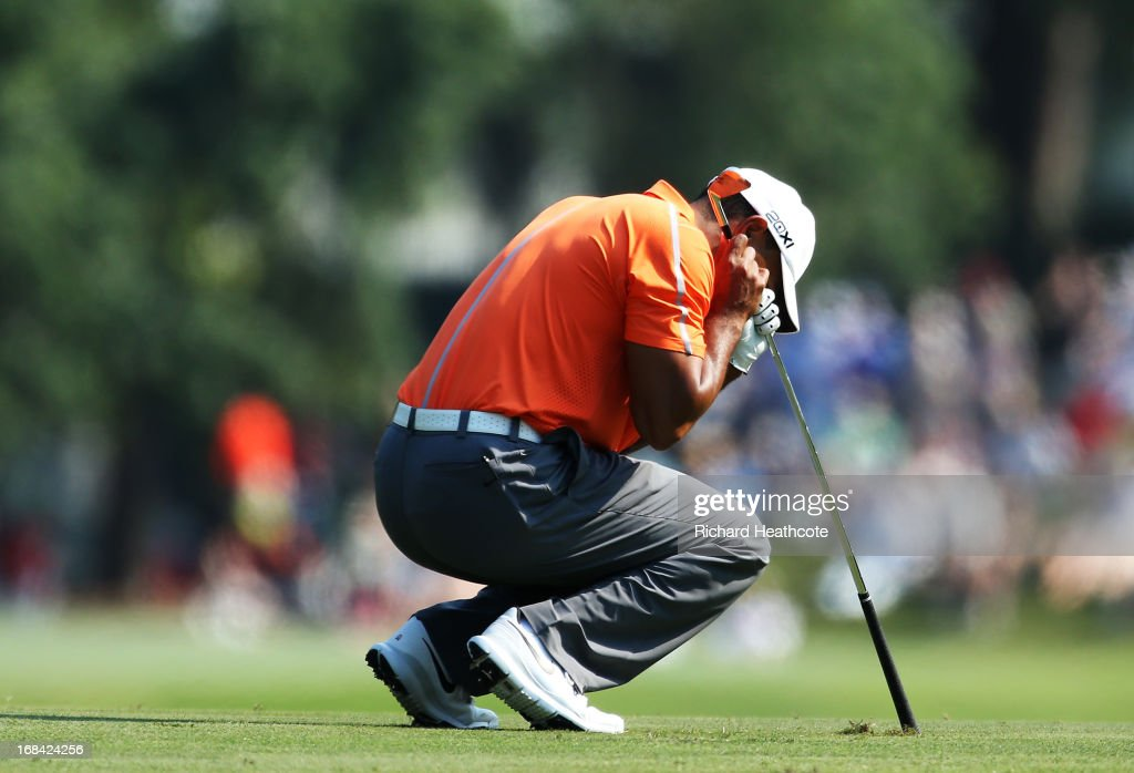 Tiger Woods of the USA reacts to his second shot on the 11th hole during round one of THE PLAYERS Championship at THE PLAYERS Stadium course at TPC Sawgrass on May 9, 2013 in Ponte Vedra Beach, Florida.