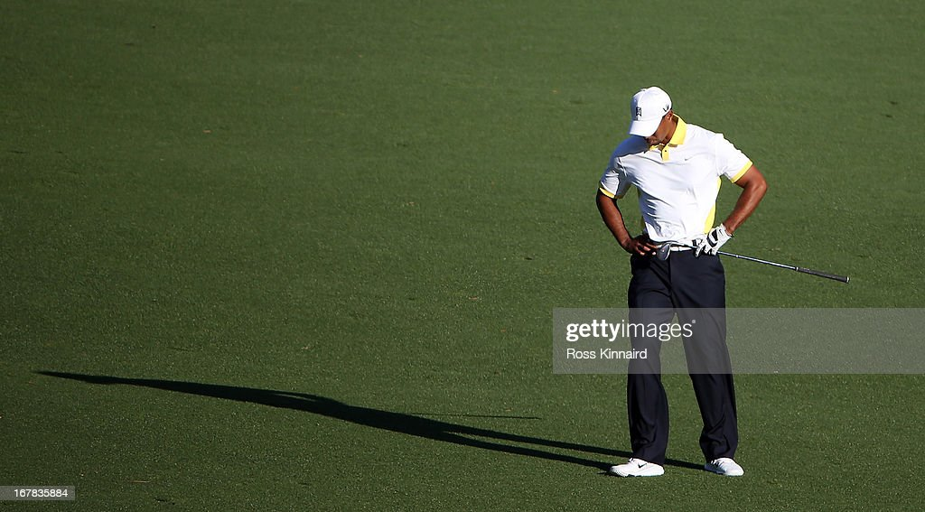 Tiger Woods of the USA reacts to his third shot on the par five 15th hole during the second round of the 2013 Masters at the Augusta National Golf Club on April 12, 2013 in Augusta, Georgia.
