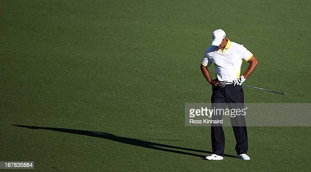 Tiger Woods of the USA reacts to his third shot on the par five 15th hole during the second round of the 2013 Masters at the Augusta National Golf...