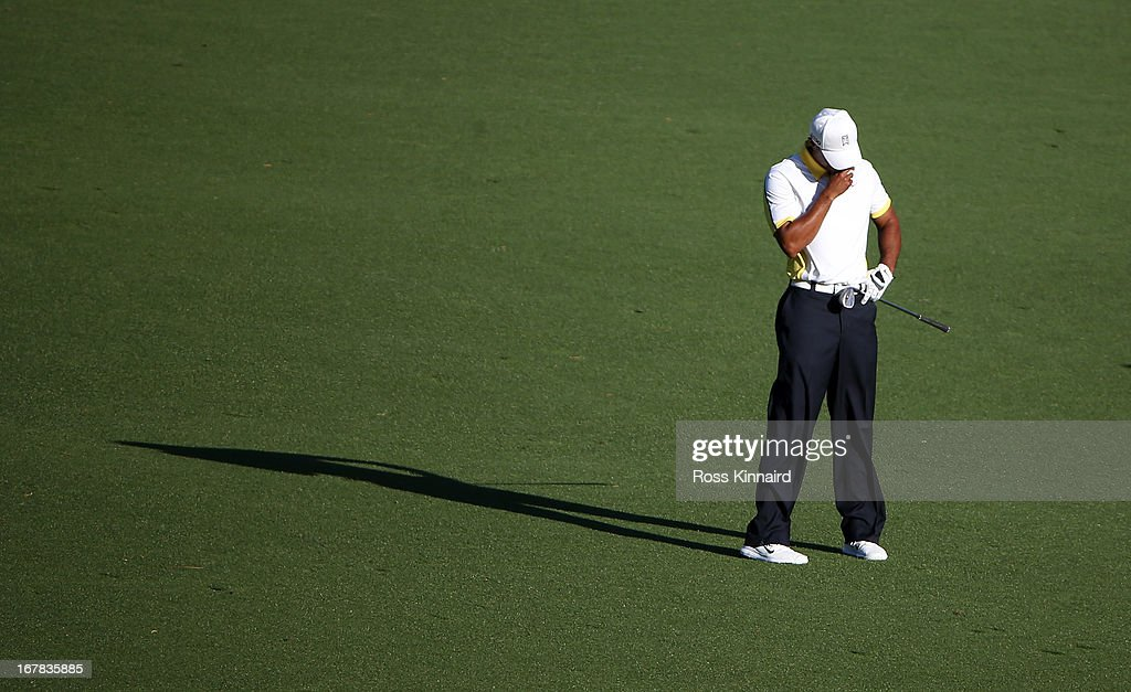 <a gi-track='captionPersonalityLinkClicked' href=/galleries/search?phrase=Tiger+Woods&family=editorial&specificpeople=157537 ng-click='$event.stopPropagation()'>Tiger Woods</a> of the USA reacts to his third shot on the par five 15th hole during the second round of the 2013 Masters at the Augusta National Golf Club on April 12, 2013 in Augusta, Georgia.
