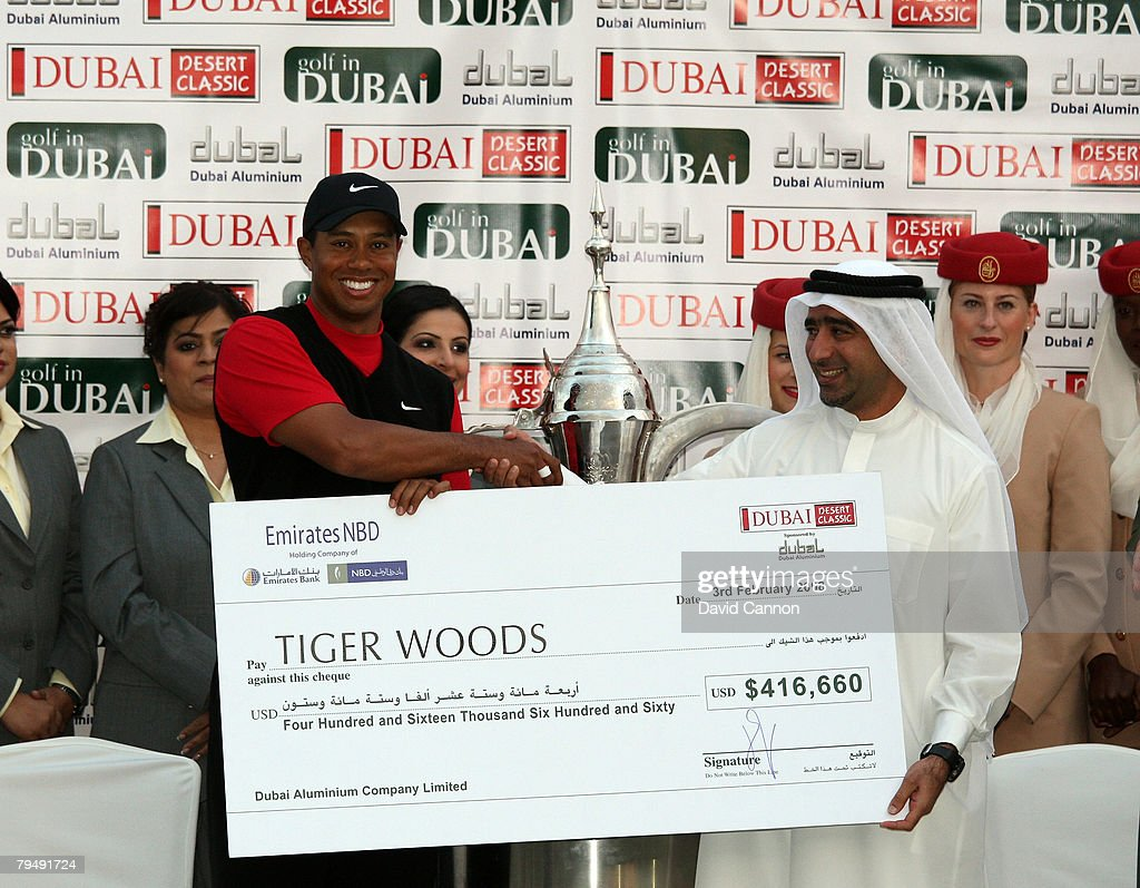 Tiger Woods of the USA receives his winners cheque after winning the Dubai Desert Classic, on the Majilis Course at the Emirates Golf Club, on February 3, 2008 in Dubai, United Arab Emirates.