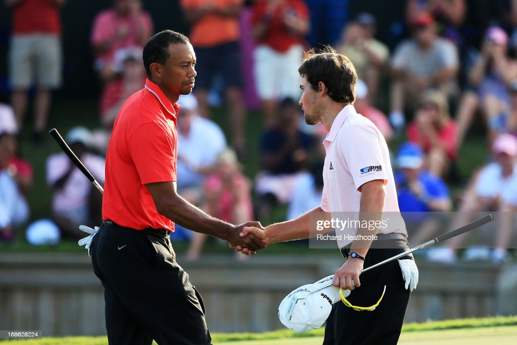 Tiger Woods of the USA shakes hands with Casey Wittenberg after finishing on the 18th green during the final round of THE PLAYERS Championship at THE PLAYERS Stadium course at TPC Sawgrass on May 12, 2013 in Ponte Vedra Beach, Florida.