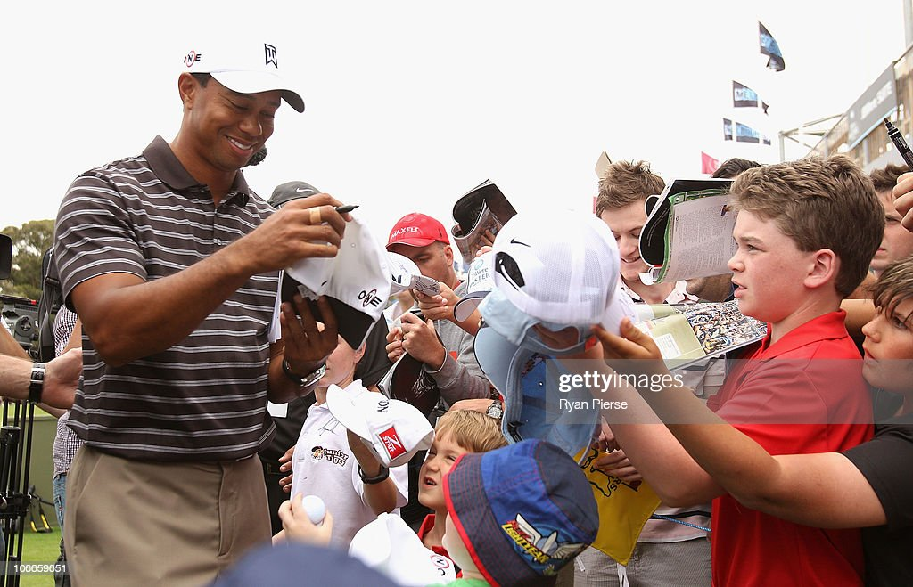 Tiger Woods of the USA signs autographs after the ProAm ahead of the Australian Masters at The Victoria Golf Club on November 10 2010 in Melbourne...