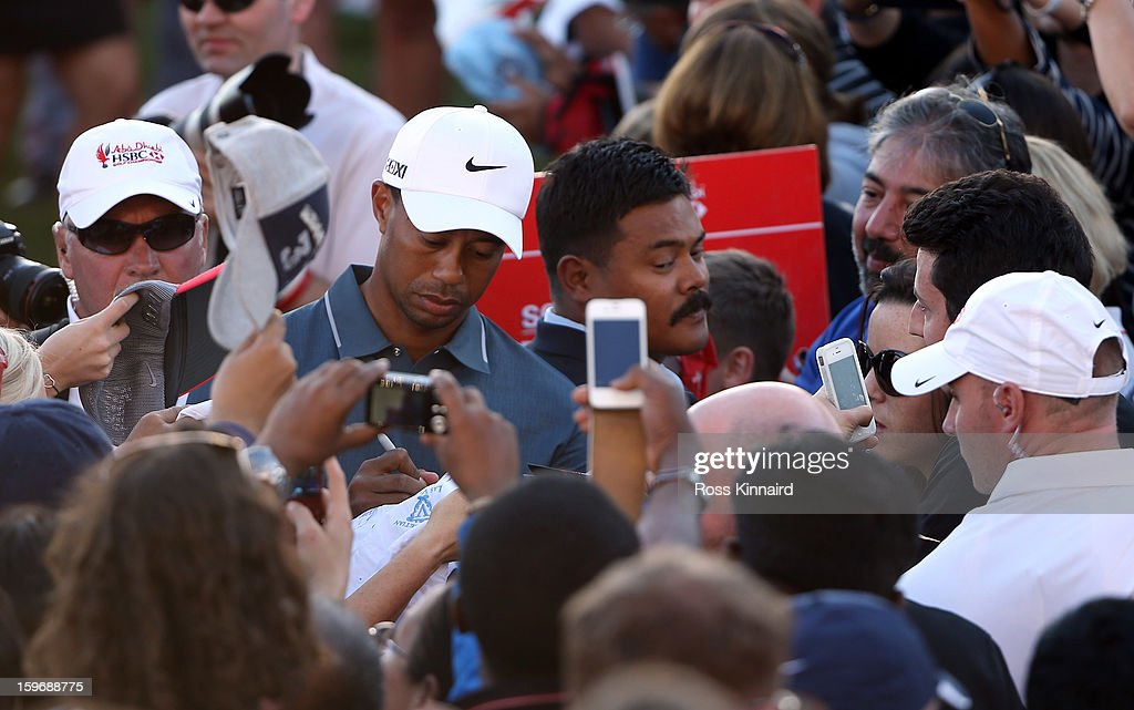 Tiger Woods of the USA sings autographs after his round during the second round of the Abu Dhabi HSBC Golf Championship at the Abu Dhabi Golf Club on January 18, 2013 in Abu Dhabi, United Arab Emirates.