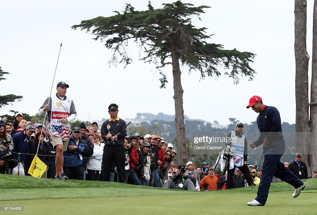 Tiger Woods of the USA Team birdies the 9th hole in his match against YEYang of South Korea and the International Team during the Day Four Singles...