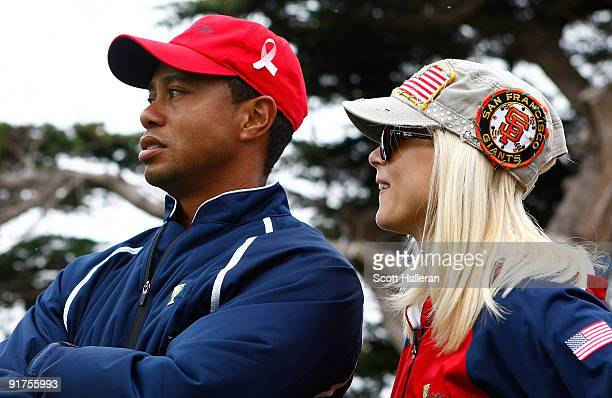 Tiger Woods of the USA Team waits with his wife Elin on the 13th green during the Final Round Singles Matches of The Presidents Cup at Harding Park...