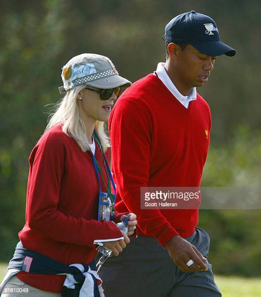 Tiger Woods of the USA Team walks with his wife Elin during the Day One Foursome Matches of The Presidents Cup at Harding Park Golf Course on October...