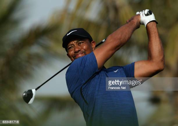 Tiger Woods of the USA tees off on the 13th hole during the first round of the Omega Dubai Desert Classic on the Majlis Course at Emirates Golf Club...