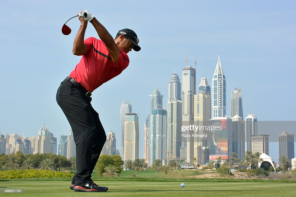 <a gi-track='captionPersonalityLinkClicked' href=/galleries/search?phrase=Tiger+Woods&family=editorial&specificpeople=157537 ng-click='$event.stopPropagation()'>Tiger Woods</a> of the USA tees off on the 8th hole during the final round of the Omega Dubai Desert Classic on the Majlis Course at the Emirates Golf Club on February 2, 2014 in Dubai, United Arab Emirates.