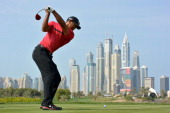 Tiger Woods of the USA tees off on the 8th hole during the final round of the Omega Dubai Desert Classic on the Majlis Course at the Emirates Golf...