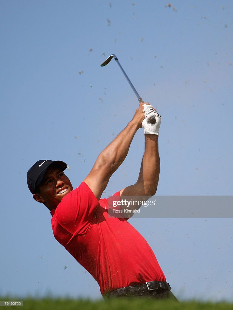 Tiger Woods of the USA tees off on the par three 4th hole during the final round of the Dubai Desert Classic on the Majlis Course held at the Emirates Golf Club on February 3, 2008 in Dubai,United Arab Emirates.
