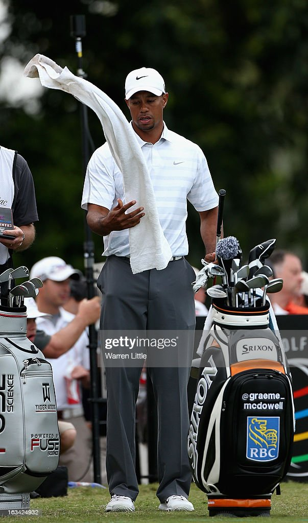 Tiger Woods of the USA tosses up his towel during the third round of the WGC - Cadillac Championship at the Trump Doral Golf Resort & Spa on March 9, 2013 in Doral, Florida.