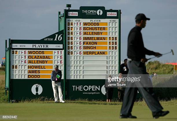 Tiger Woods of the USA walks past a leaderboard on the 17th hole during the second round of the 134th Open Championship at Old Course St Andrews Golf...