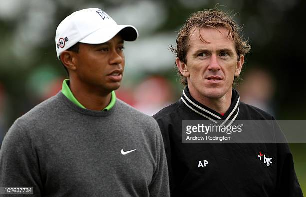 Tiger Woods of the USA walks with jockey Tony McCoy during the second round of The JP McManus Invitational ProAm event at the Adare Manor Hotel and...