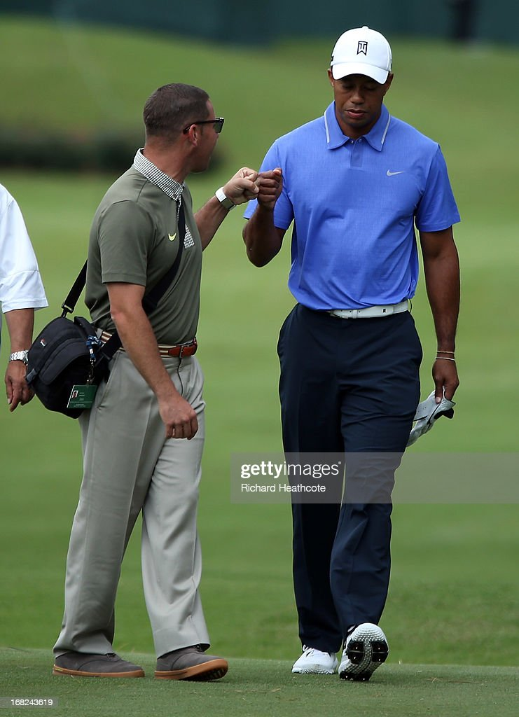 Tiger Woods of the USA with his coach Sean Foley during a practise round for THE PLAYERS Championship at TPC Sawgrass on May 7, 2013 in Ponte Vedra Beach, Florida.