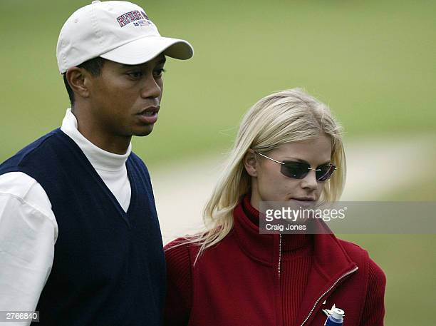 Tiger Woods of the USA with his girlfriend Elin Nordegren on the 17th green after his defeat during the afternoon foursome matches on the first day...