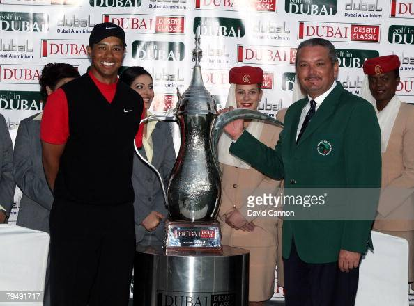 Tiger Woods of the USA with the trophy with The Emirates Golf Club Gentlemans Captain after winning the Dubai Desert Classic on the Majilis Course at...