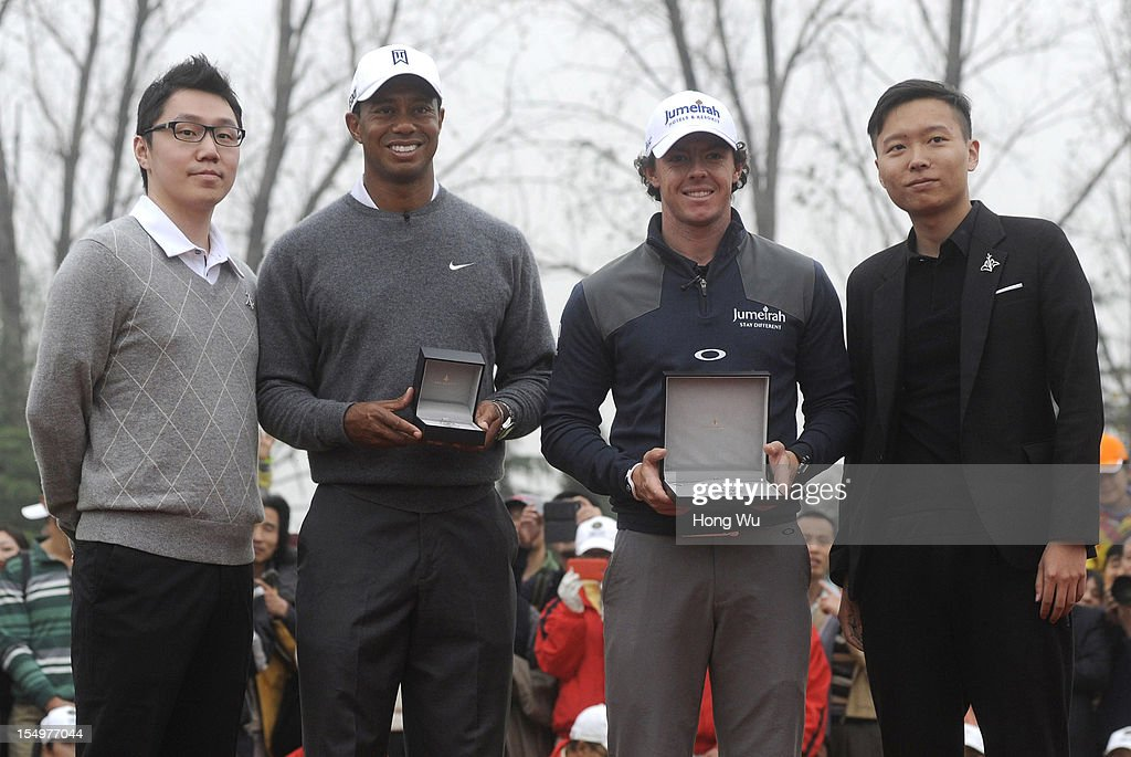 <a gi-track='captionPersonalityLinkClicked' href=/galleries/search?phrase=Tiger+Woods&family=editorial&specificpeople=157537 ng-click='$event.stopPropagation()'>Tiger Woods</a> of USA (2nd L) and <a gi-track='captionPersonalityLinkClicked' href=/galleries/search?phrase=Rory+McIlroy&family=editorial&specificpeople=783109 ng-click='$event.stopPropagation()'>Rory McIlroy</a> of Northern Ireland (3rd L) at the award ceremony during the Duel of <a gi-track='captionPersonalityLinkClicked' href=/galleries/search?phrase=Tiger+Woods&family=editorial&specificpeople=157537 ng-click='$event.stopPropagation()'>Tiger Woods</a> and <a gi-track='captionPersonalityLinkClicked' href=/galleries/search?phrase=Rory+McIlroy&family=editorial&specificpeople=783109 ng-click='$event.stopPropagation()'>Rory McIlroy</a> at Jinsha Lake Golf Club on October 29, 2012 in Zhengzhou, China.