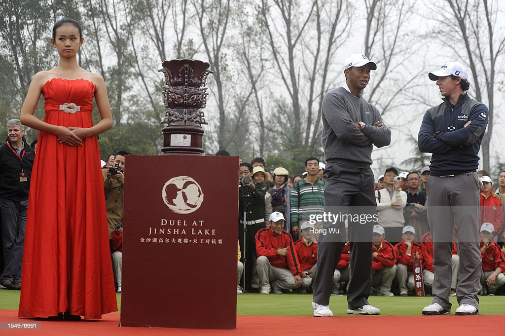 <a gi-track='captionPersonalityLinkClicked' href=/galleries/search?phrase=Tiger+Woods&family=editorial&specificpeople=157537 ng-click='$event.stopPropagation()'>Tiger Woods</a> of USA (C) and <a gi-track='captionPersonalityLinkClicked' href=/galleries/search?phrase=Rory+McIlroy&family=editorial&specificpeople=783109 ng-click='$event.stopPropagation()'>Rory McIlroy</a> of Northern Ireland (R) talk at the award ceremony during the Duel of <a gi-track='captionPersonalityLinkClicked' href=/galleries/search?phrase=Tiger+Woods&family=editorial&specificpeople=157537 ng-click='$event.stopPropagation()'>Tiger Woods</a> and <a gi-track='captionPersonalityLinkClicked' href=/galleries/search?phrase=Rory+McIlroy&family=editorial&specificpeople=783109 ng-click='$event.stopPropagation()'>Rory McIlroy</a> at Jinsha Lake Golf Club on October 29, 2012 in Zhengzhou, China.