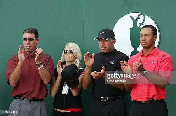 Tiger Woods of USA caddy Steve Williams Elin Woods and manager Mark Steinberg applaud during the speeches prior to the presentation of the claret jug...