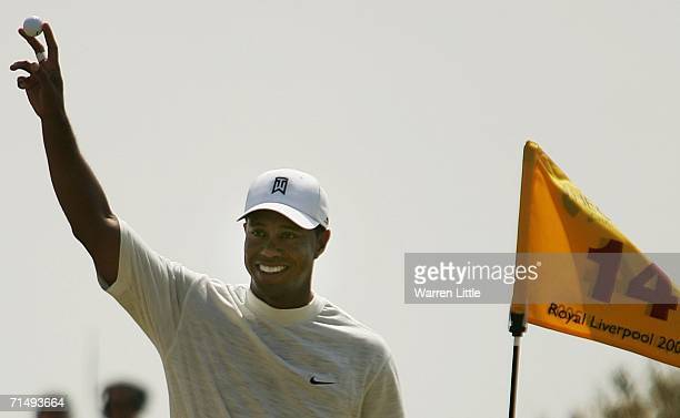 Tiger Woods of USA celebrates holing his approach shot on the 14th hole for an eagle during the second round of The Open Championship at Royal...