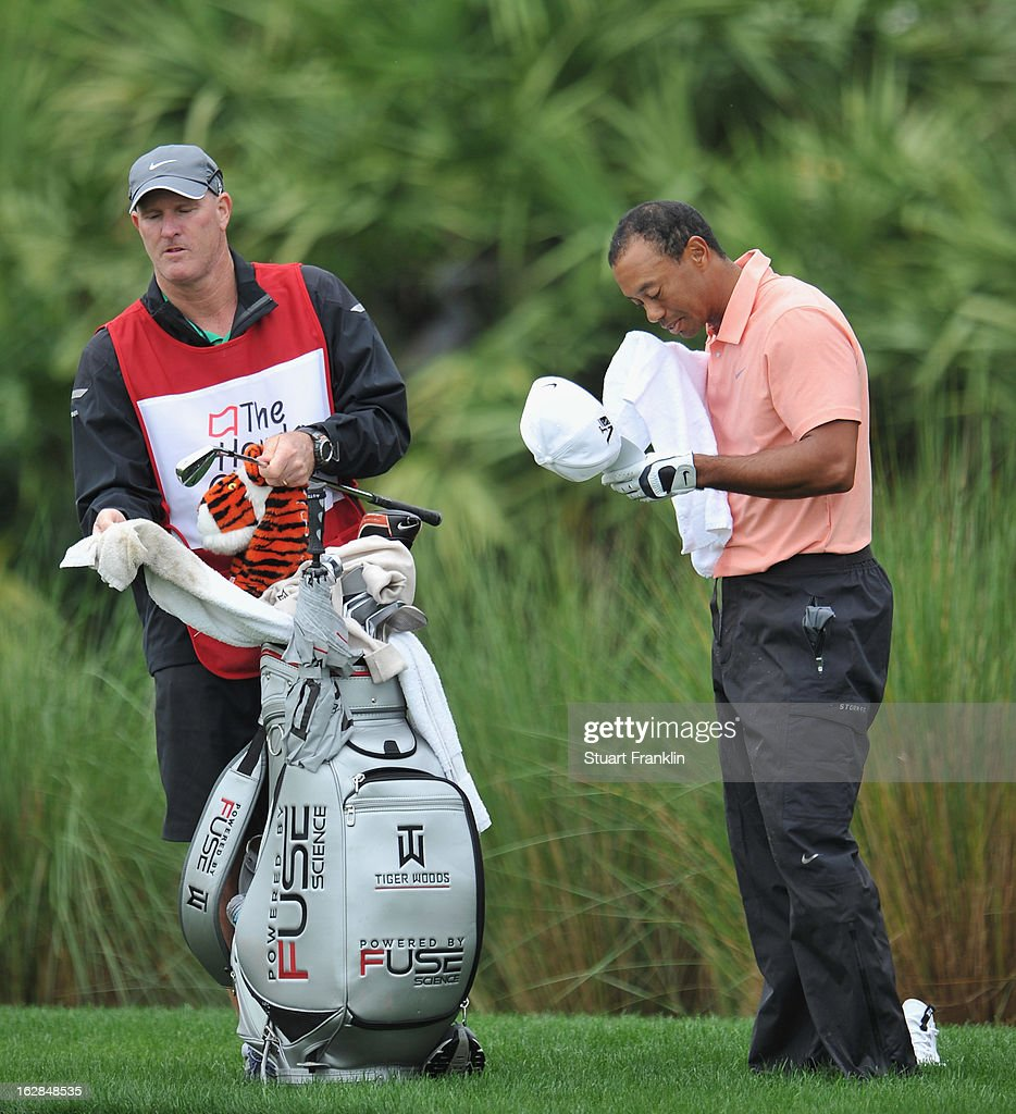 Tiger Woods of USA cleans himself up on the sixth hole having played from by the water during the first round of the Honda Classic on February 28, 2013 in Palm Beach Gardens, Florida.