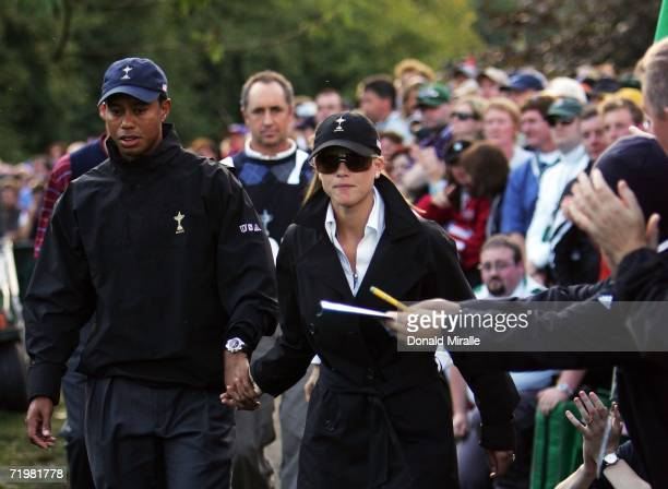 Tiger Woods of USA exits the course with wife Elin after Europe win the Ryder Cup by a score of 18 1/2 9 1/2 on the final day of the 2006 Ryder Cup...
