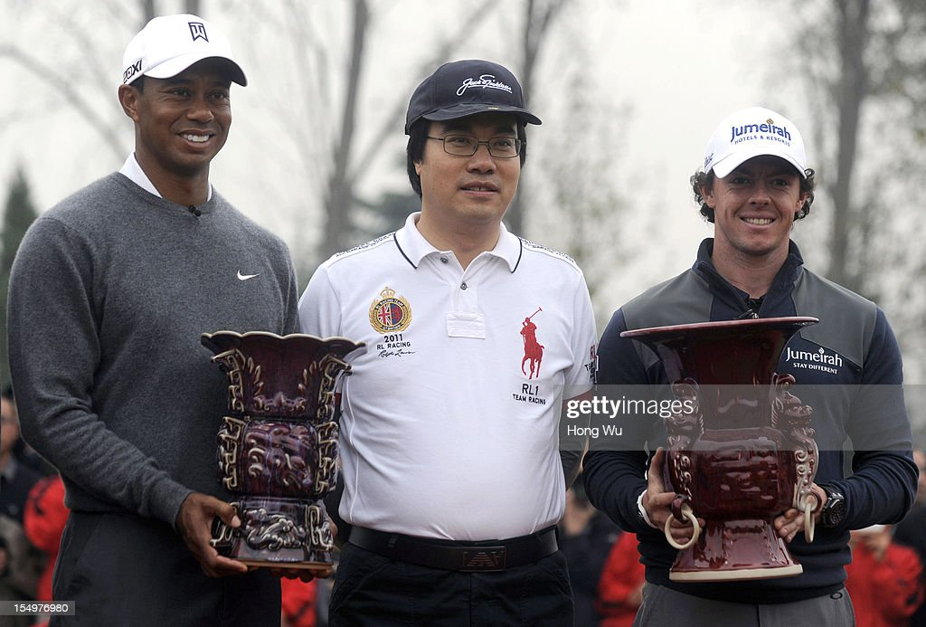 <a gi-track='captionPersonalityLinkClicked' href=/galleries/search?phrase=Tiger+Woods&family=editorial&specificpeople=157537 ng-click='$event.stopPropagation()'>Tiger Woods</a> of USA (L); Feng Changge, Chairman Harmony Group (C) and <a gi-track='captionPersonalityLinkClicked' href=/galleries/search?phrase=Rory+McIlroy&family=editorial&specificpeople=783109 ng-click='$event.stopPropagation()'>Rory McIlroy</a> of Northern Ireland hold trophies at the award ceremony during the Duel of <a gi-track='captionPersonalityLinkClicked' href=/galleries/search?phrase=Tiger+Woods&family=editorial&specificpeople=157537 ng-click='$event.stopPropagation()'>Tiger Woods</a> and <a gi-track='captionPersonalityLinkClicked' href=/galleries/search?phrase=Rory+McIlroy&family=editorial&specificpeople=783109 ng-click='$event.stopPropagation()'>Rory McIlroy</a> at Jinsha Lake Golf Club on October 29, 2012 in Zhengzhou, China.