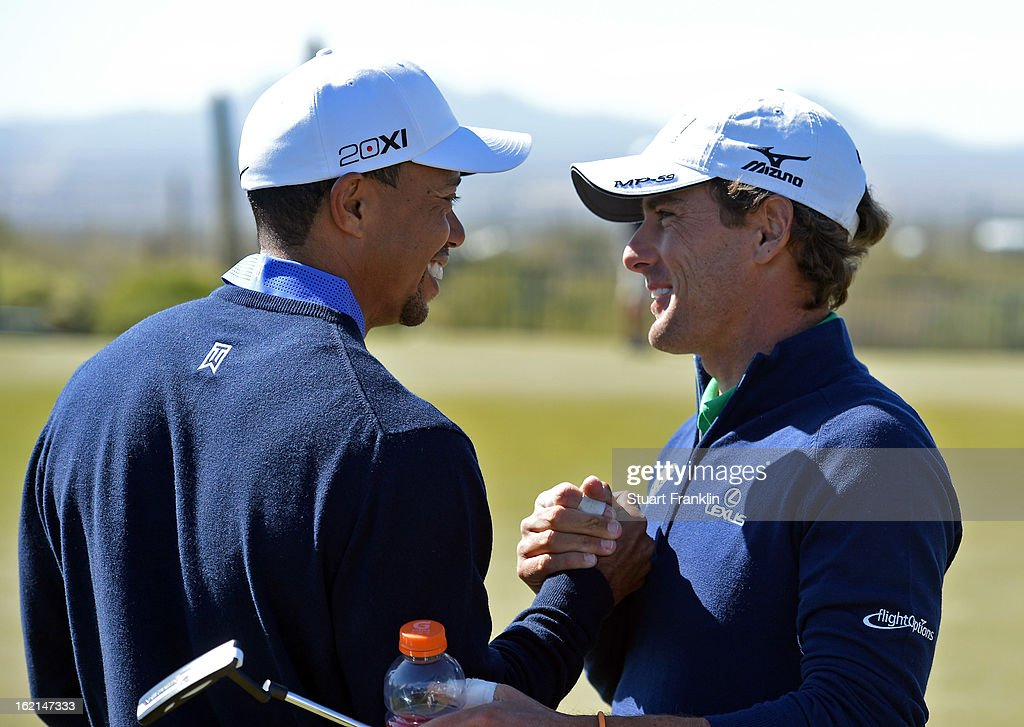 Tiger Woods of USA greets his apponant of the first day Charles Howell III of USA during practice prior to the start of the World Golf Championships-Accenture Match Play Championship at the Ritz-Carlton Golf Club on February 19, 2013 in Marana, Arizona.