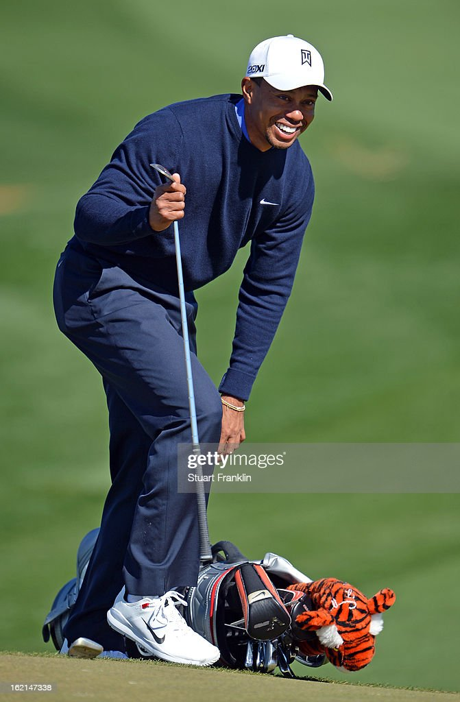 Tiger Woods of USA looks happy during practice prior to the start of the World Golf Championships-Accenture Match Play Championship at the Ritz-Carlton Golf Club on February 19, 2013 in Marana, Arizona.
