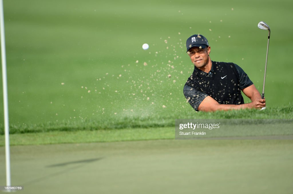Tiger Woods of USA plays a bunker shot on the nineth hole during the third round of the Honda Classic on March 2, 2013 in Palm Beach Gardens, Florida.