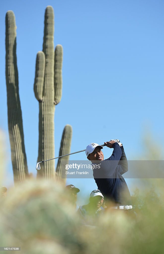 <a gi-track='captionPersonalityLinkClicked' href=/galleries/search?phrase=Tiger+Woods&family=editorial&specificpeople=157537 ng-click='$event.stopPropagation()'>Tiger Woods</a> of USA plays a shot during practice prior to the start of the World Golf Championships-Accenture Match Play Championship at the Ritz-Carlton Golf Club on February 19, 2013 in Marana, Arizona.